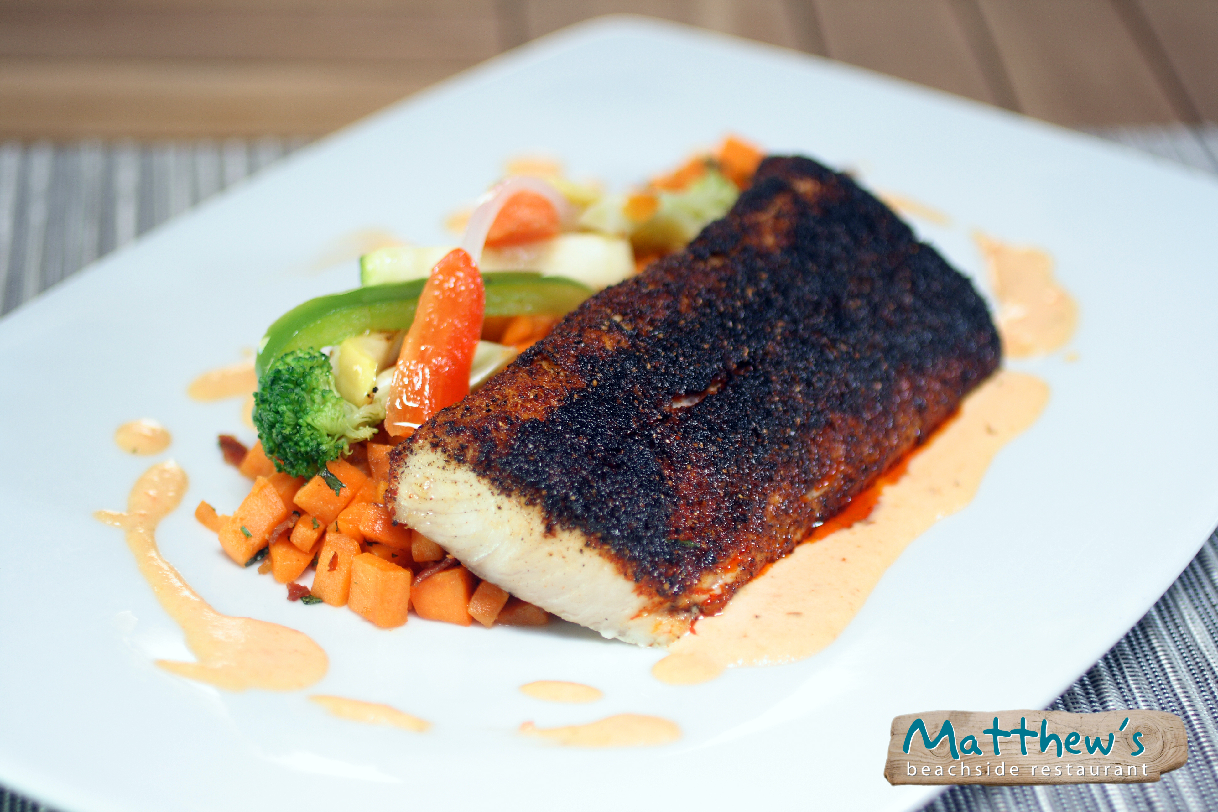 Seared corvina fish with a side of veggies